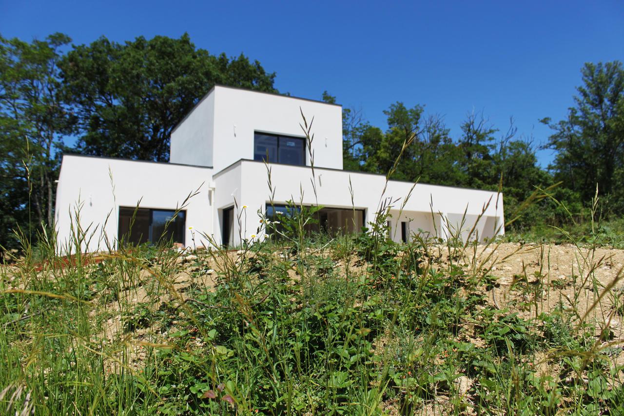Une maison toiture plate bon encontre constructeur de for Prix metre carre construction maison