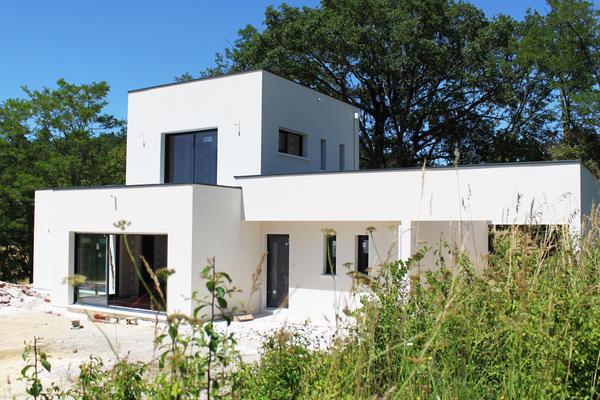 Maison contemporaine toiture plate - Mètre Carré