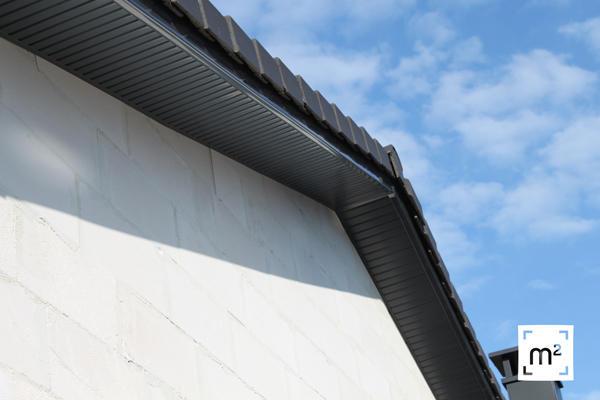 Construction d 39 une maison basse consommation de 150m2 aux for Pose lambris pvc sous avant toit