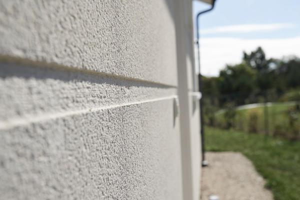 Enduit ton pierre avec double rainurage - Constructeur de maisons Mètre Carré